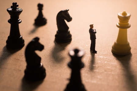 business game: Concept of business strategy. Businessman with chess game.