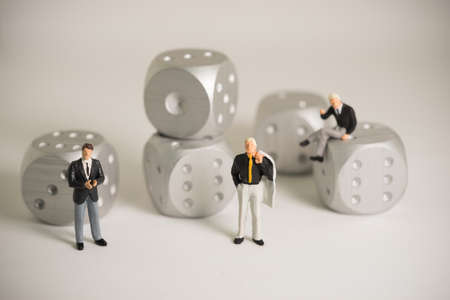 rolling dice: Concept of business risk. Businessmen standing with rolling dice. Stock Photo