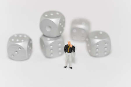 rolling dice: Concept of business risk. Businessman standing with rolling dice.