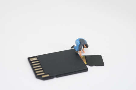 data recovery: Concept of data recovery. Worker working on micro sd card. Stock Photo
