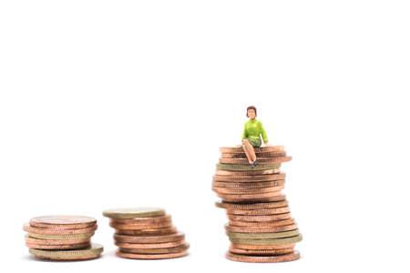 finacial: Concept of success finacial. Woman sitting on stack of coin.