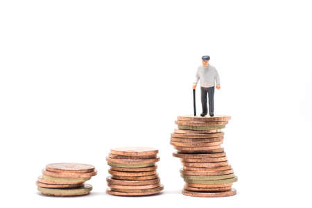 old man standing: Concept of retirement planning. Old man standing on stack step of coin.