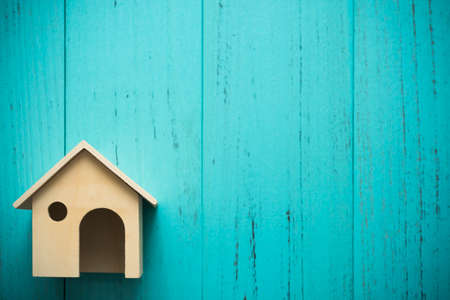 Miniature wood house on grunge background with copyspace Stock Photo