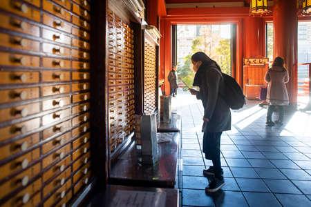 Tokyo, Japan - February 16, 2017 : Tourist doing fortune teller at Sensoji Temple .