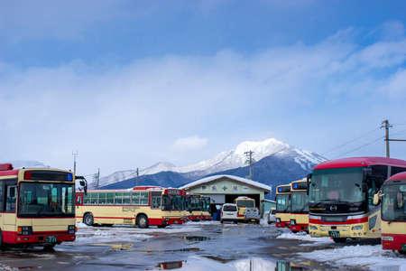 Nagano, Japan - February 13, 2017 : Shuttle bus stopping at Yudanaka bus station in winter