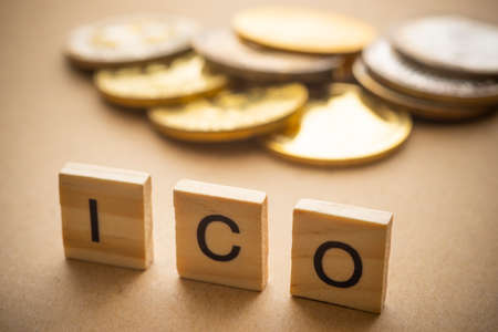 ICO on wood. Initial coin offering concept