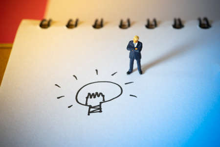Business concept of innovative. Businessman standing with doodle idea lightbulb