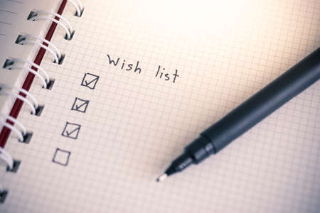 Wish list writing on notebook paper Reklamní fotografie