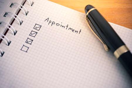 Appointment list writing on notebook paper Reklamní fotografie