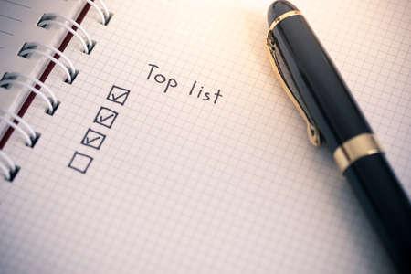 Top list writing on notebook paper Reklamní fotografie