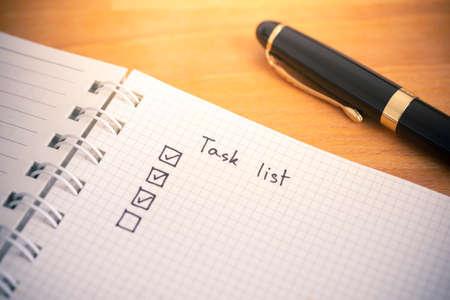 Tasks list writing on notebook paper