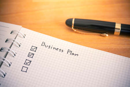 Business plan writing on notebook paper