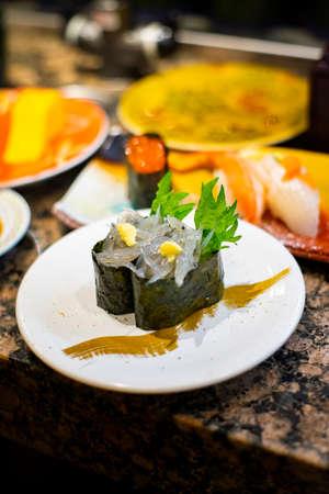 Bite of sushi made from little sardine call Shirasu. Famous dish in Kamakura area