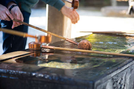 Mouth and hand washing bucket in front of Shrine or Temple.