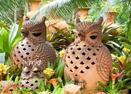 Ceramic owls in park with colors photo