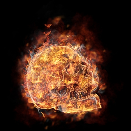 Burning skull on black background photo