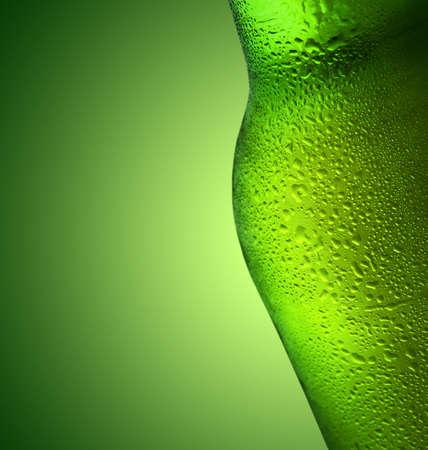 refreshes: beer bottle over green background