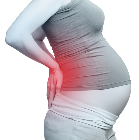dolor de estomago: la mujer embarazada. aislado m�s de blanco