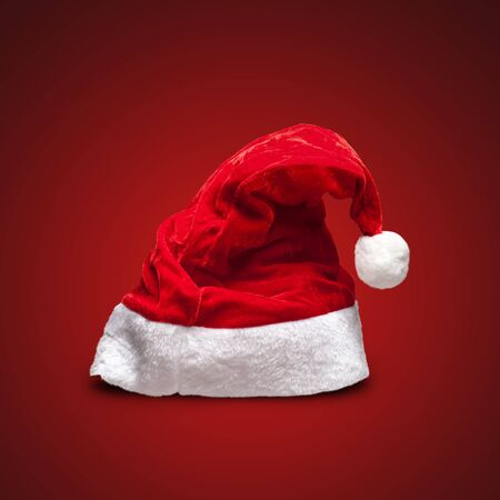 red hat: Single Santa Claus red hat on red background