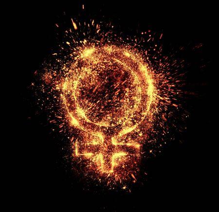 female symbol: female symbol spark is isolated on black background