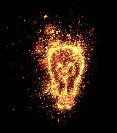 light to dark: light bulb symbol spark is isolated on black background