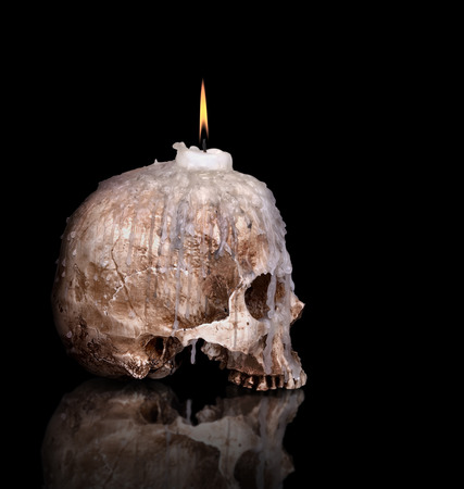 candlestick from human skull isolated on black background Stock Photo