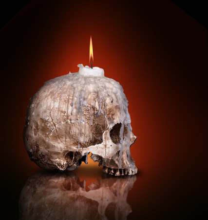 candlestick: candlestick from human skull on black background Stock Photo