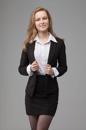 business portrait of smiling woman. on gray background