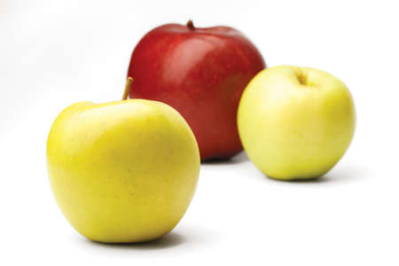 Two yellow and one red apple on a white background Stockfoto