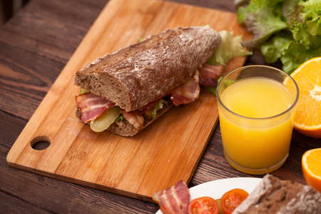 homemade food. sandwich cooking on a wooden table. close up Archivio Fotografico