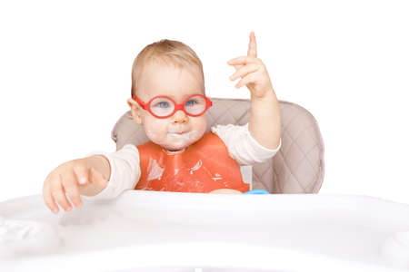 """little kid with glasses. mouth milk. finger the top. """"good idea!"""" isolated on white"""