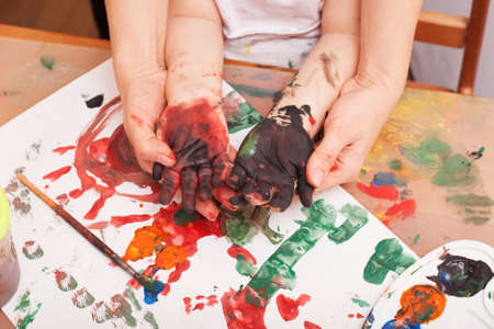 view from above. Child hands soiled in a paint. bodyart