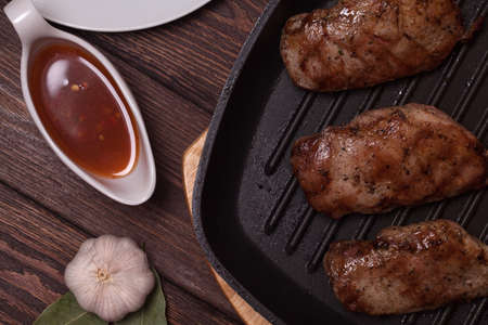 cooking duck breast on a grill pan. tasty recipe. composition of objects view on top Stok Fotoğraf