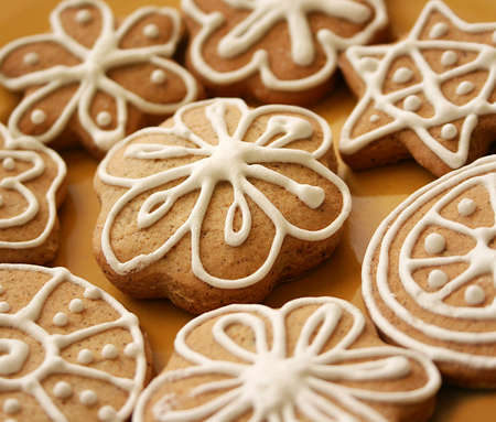 baked bread: Gingerbread cookies Arranged on yellow ceramic plate Stock Photo