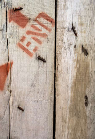 old wooden wall have nail arrow and letter on it photo