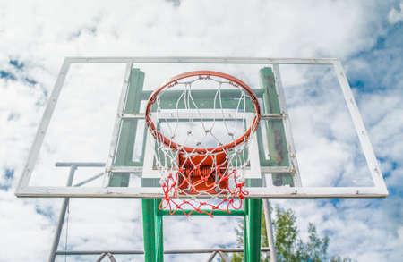 intramural: red Basketball hoop with blue sky .