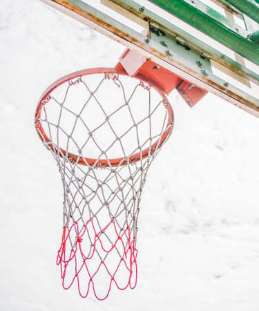 intramural: red basketball hoop and white cloud .