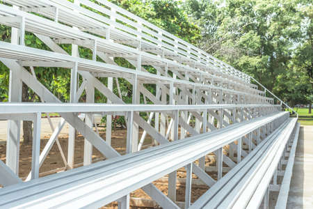 grandstand: white Grandstand Seats outdoor for looking football Stock Photo