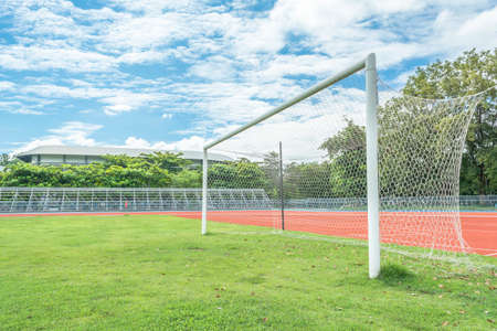 soccer goal in field with bluesky white cloud photo