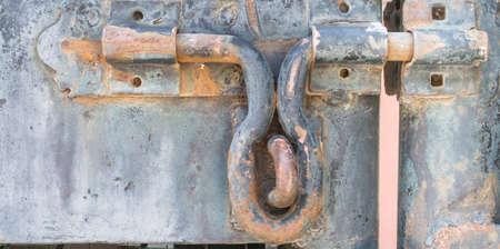 brown old rustic door lock outdoor . photo