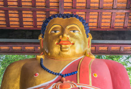 fat Golden Buddha Statue in temple , Thailand