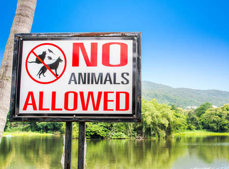 excluded: no pets allowed sign on gate in the park