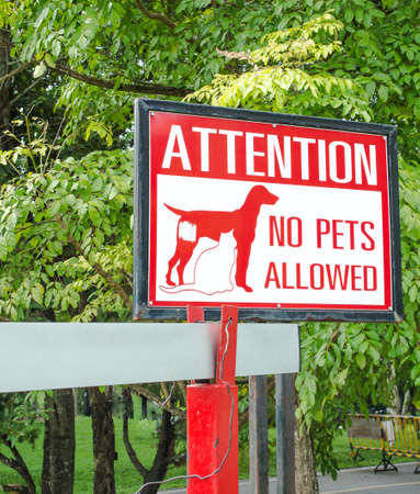 keep gate closed: No pets allowed sign on gate in the park Stock Photo