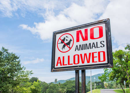 keep gate closed: no pets allowed sign in the park. Stock Photo