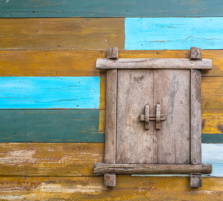 wooden window on colorful wooden wall painted photo
