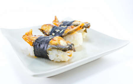 roasted eel (unagi) nigiri on ceramics dish photo