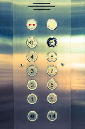 silver elevator panel have number 1 to 8 floor on it photo