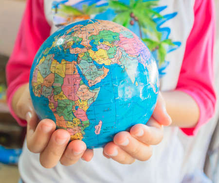 save the world with young child hand image photo
