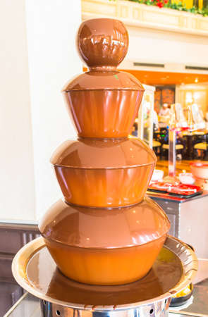 sweet and  hot chocolate fountain in the resturant photo