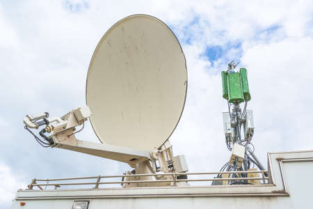 satellite dish  and antenna on television car mobile image. photo